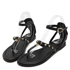 Zara black and gold flat sandals
